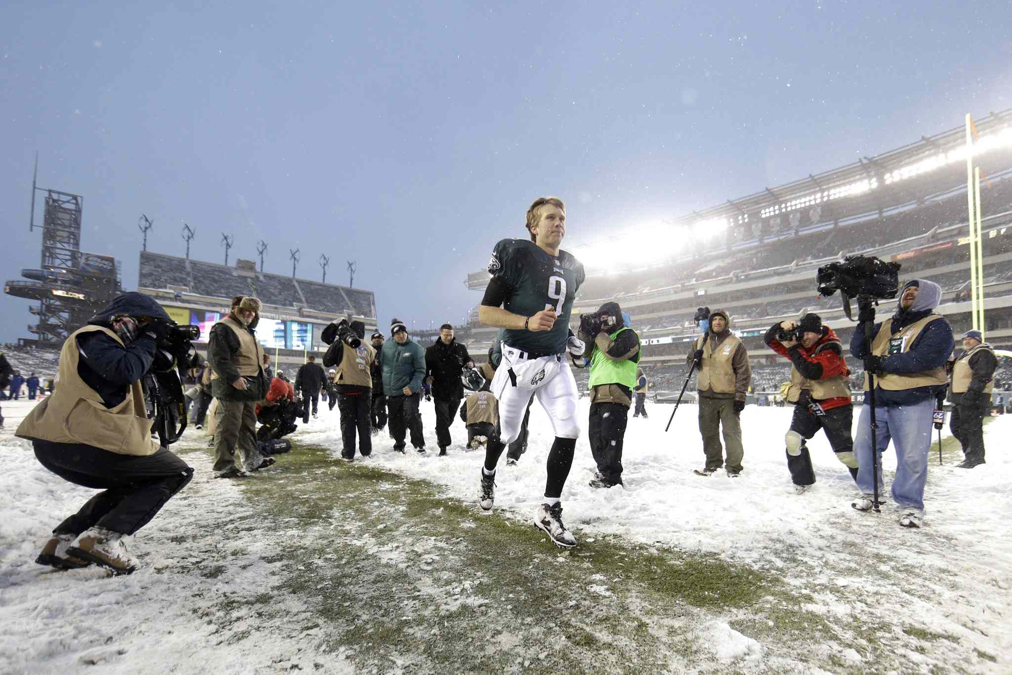 Philadelphia Eagles' Nick Foles runs off the field at the end of an NFL football game against the Detroit Lions on Sunday in Philadelphia. The Eagles won 34-20.