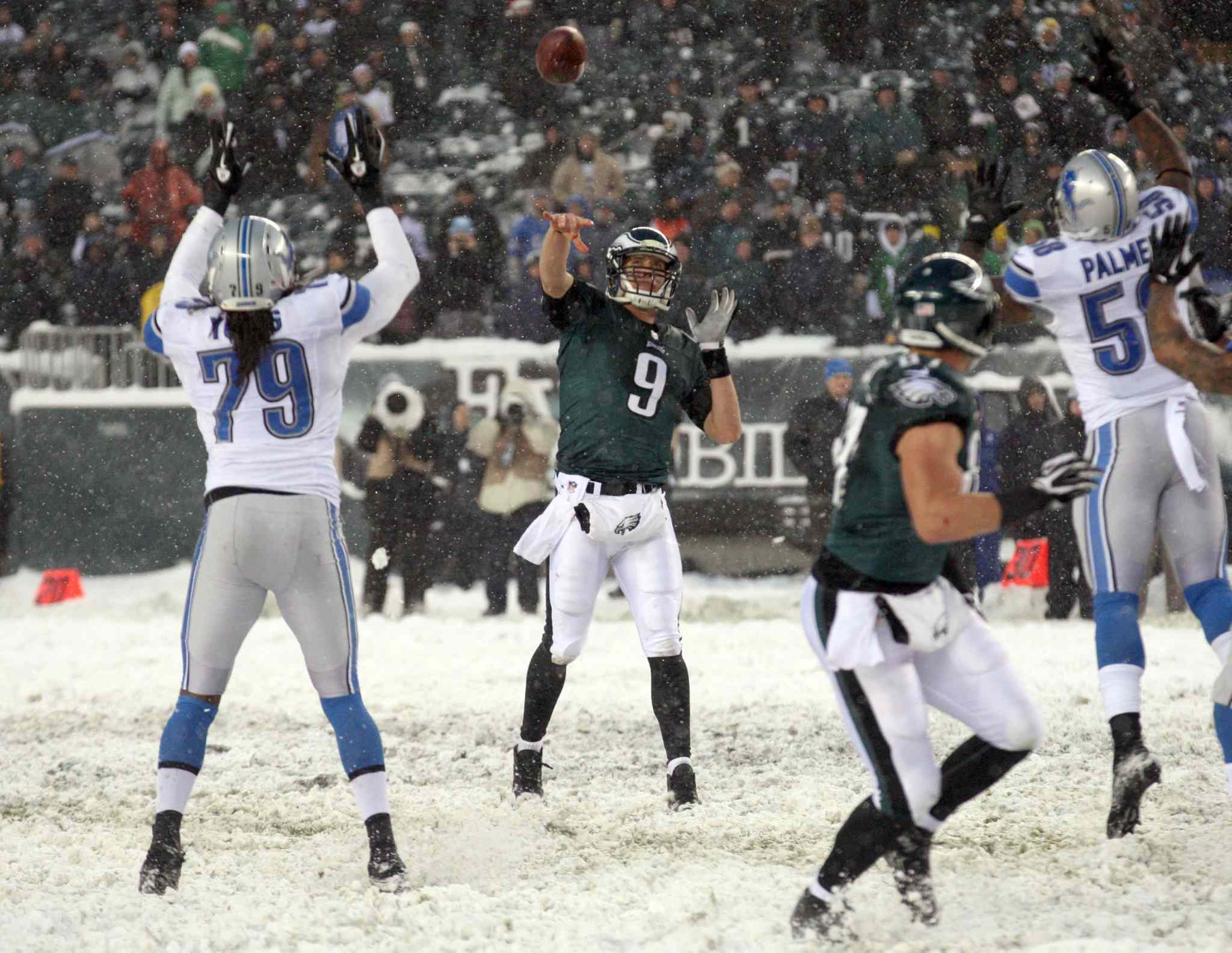 Philadelphia Eagles' Nick Foles (centre) floats the football to Brent Celek (centre right) late in the fourth quarter against the Detroit Lions at Lincoln Financial Field in Philadelphia on Sunday.