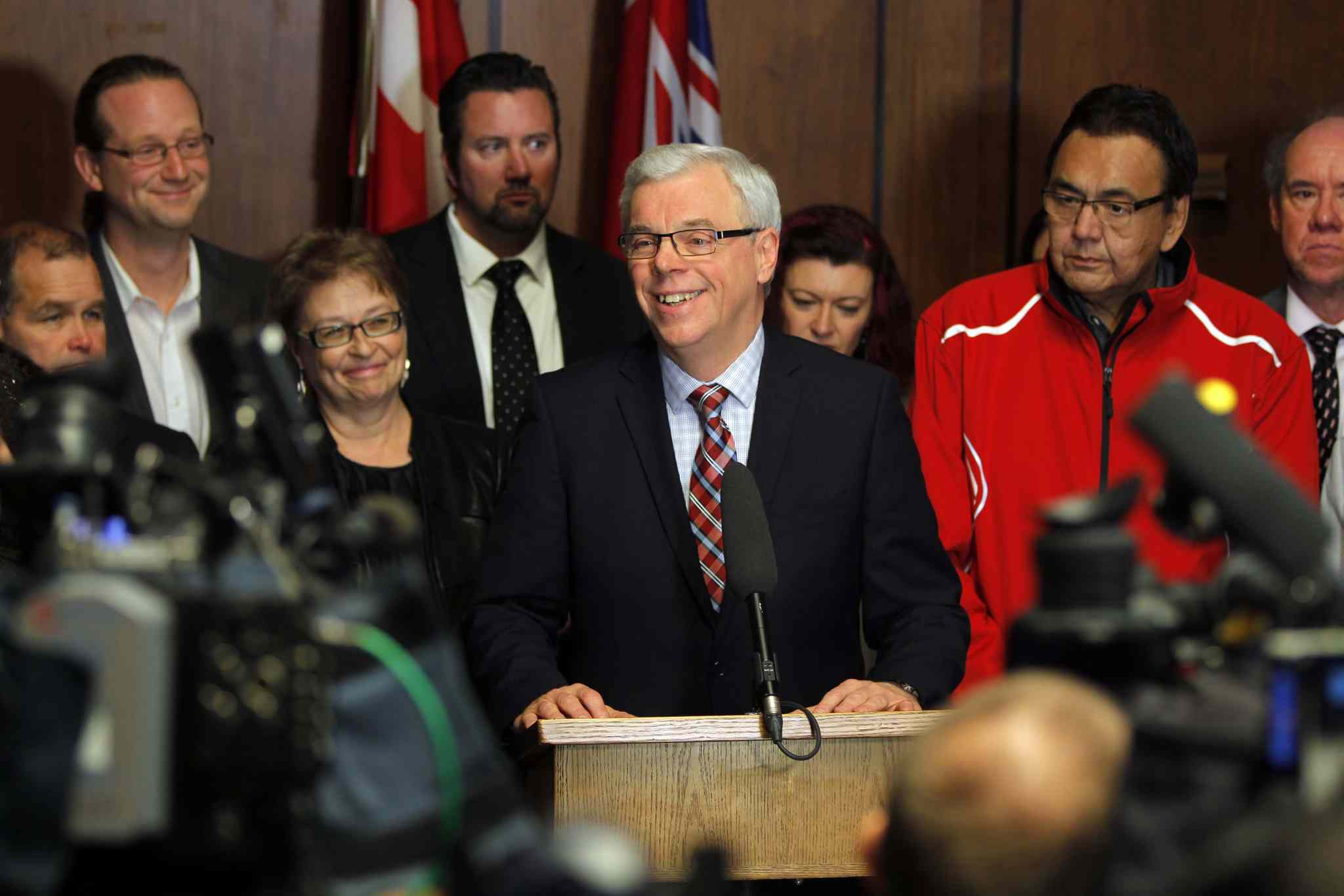 Premier Greg Selinger is supported by 15 members of his caucus as he announced Oct. 28 he is staying on as NDP leader despite pressure from five outspoken cabinet ministers who want him to quit.
