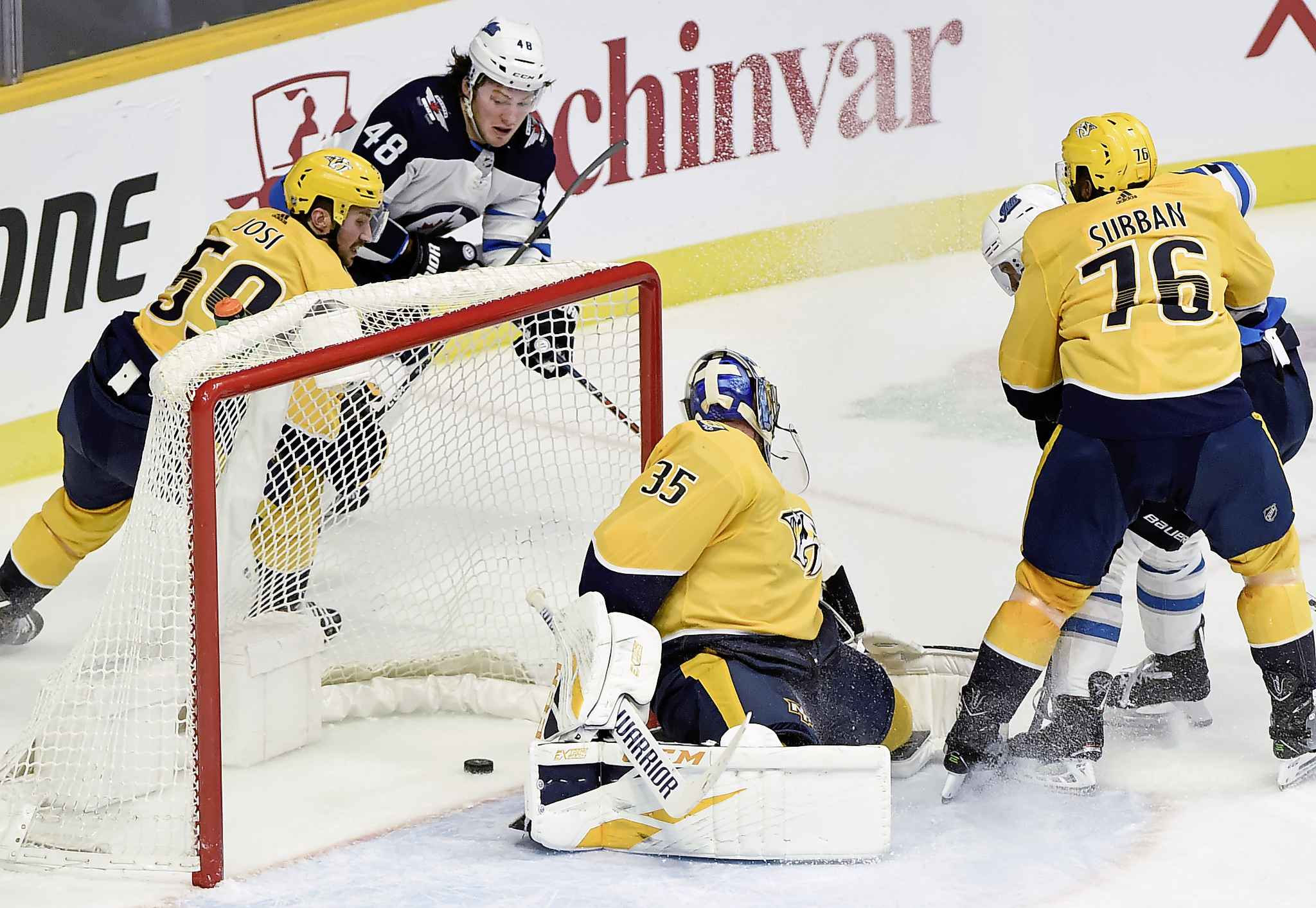 Lemieux scores a goal against Nashville Predators goaltender Pekka Rinne in January.