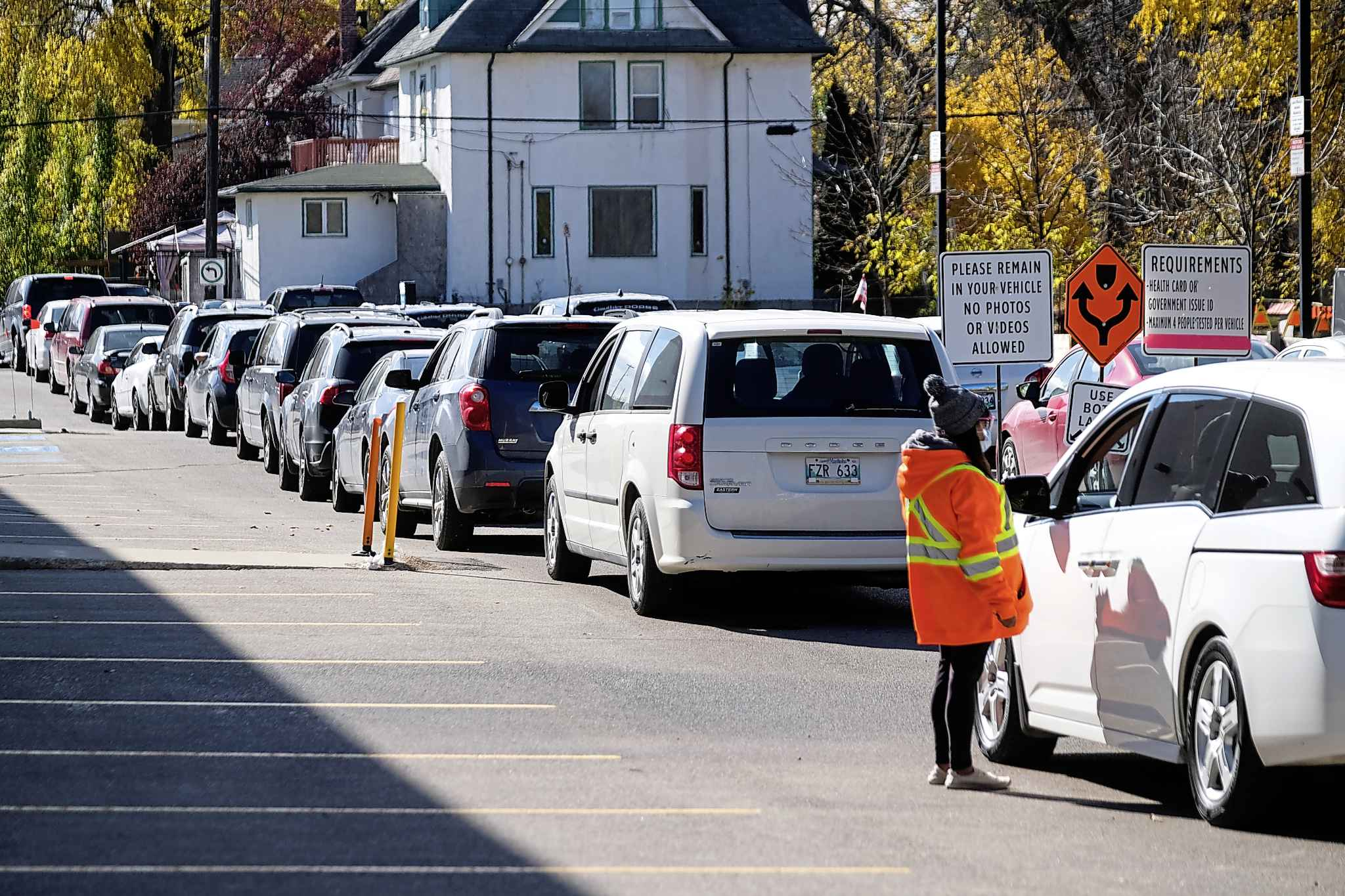 People endure long waits in their vehicles at a drive-in COVID test site in Winnipeg on Oct. 10.
