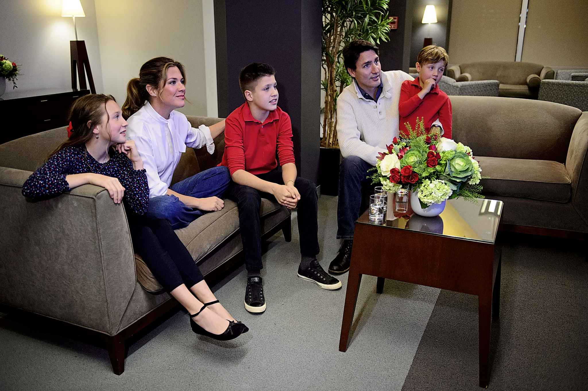 Liberal leader Justin Trudeau and wife Sophie Gregoire-Trudeau, and children Xavier, Ella-Grace and Hadrien watch election results in Montreal on Monday.