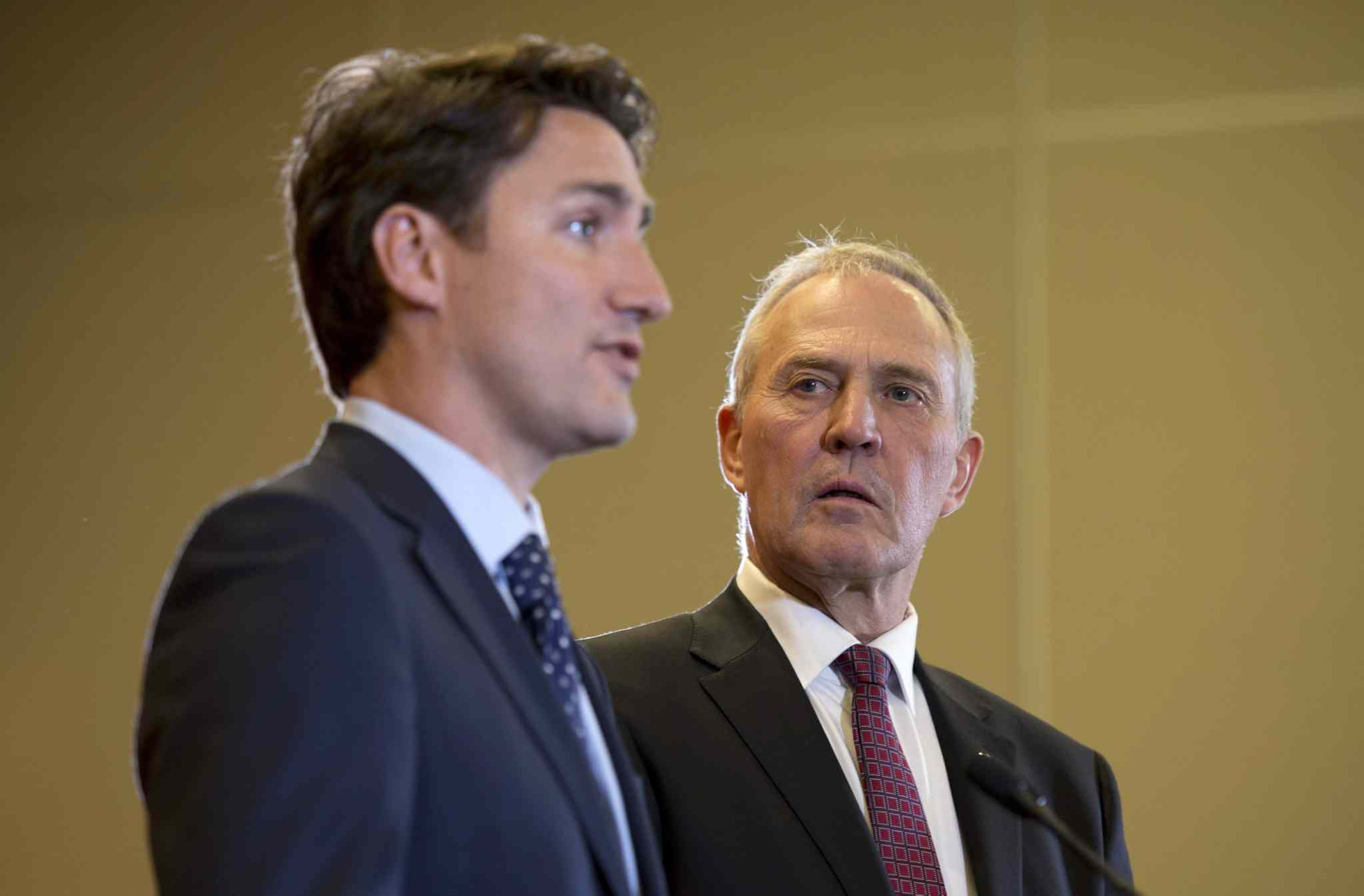 Bill Blair (right, seen with Prime Minster Justin Trudeau) thinks it's important for the federal government to hear the perspectives of Indigenous communities on marijuana. (Adrian Wyld / The Canadian Press files)