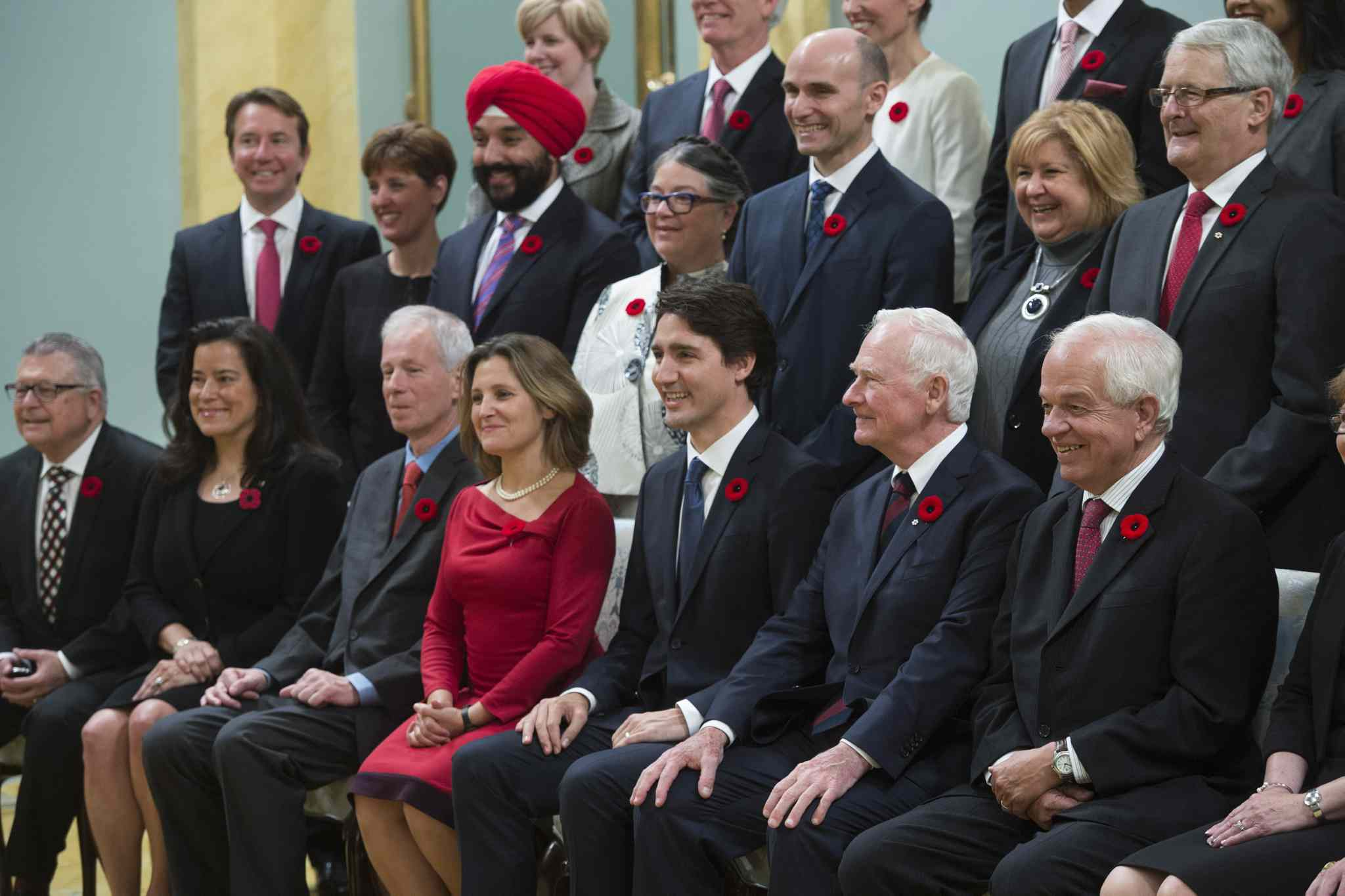 Governor General David Johnston joins Prime Minister Justin Trudeau and his new cabinet for a photo at Rideau Hall, in Ottawa.