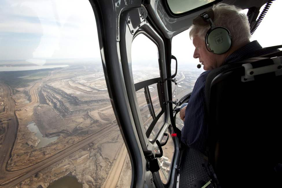 Liberal party leader Bob Rae looks out over an open pit oil sands mine as he takes a helicopter tour of the oil sands near Fort McMurray. (The Canadian Press / Jeff McIntosh)