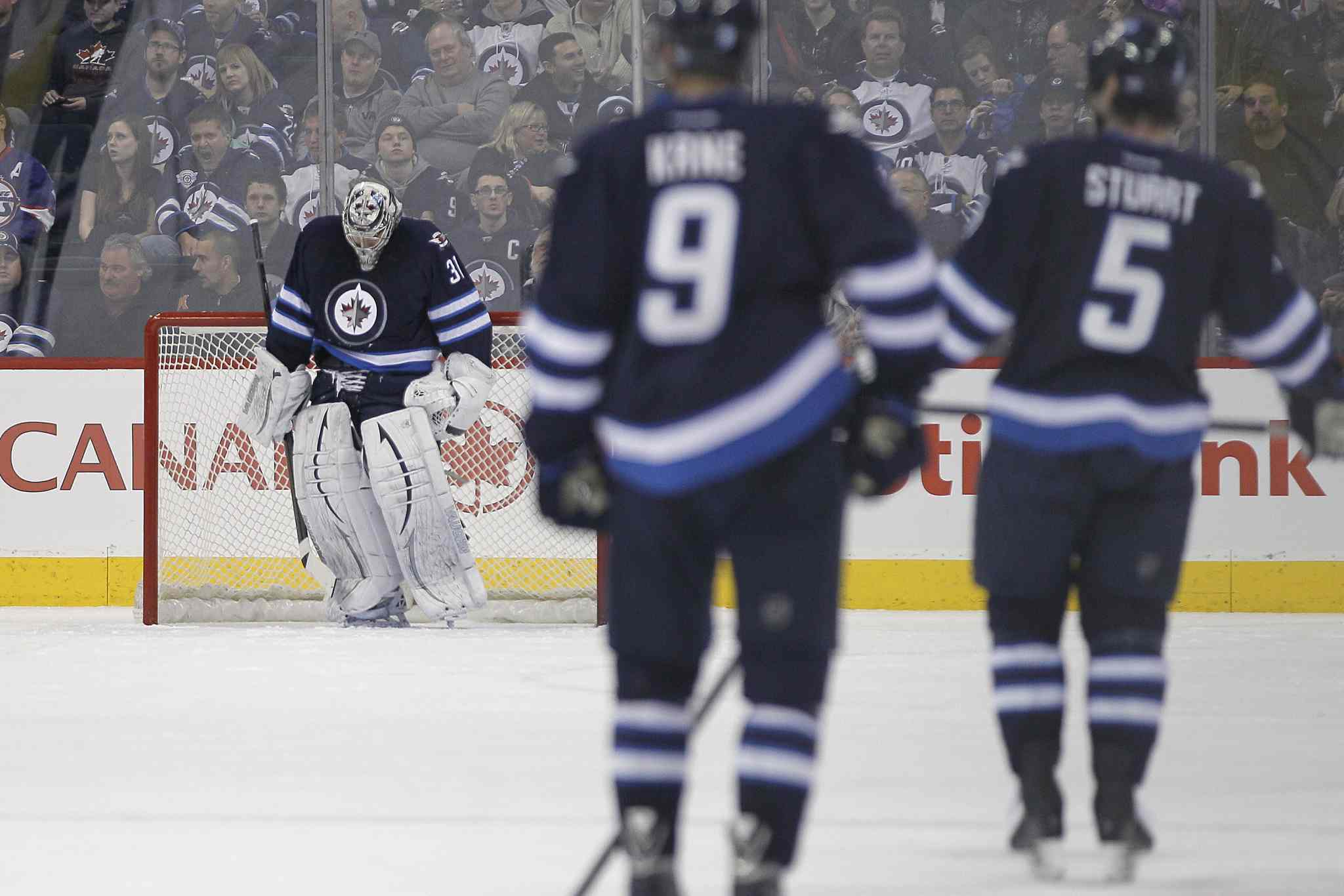Winnipeg Jets' goaltender Ondrej Pavelec (31) hangs his head after being scored on by Tampa Bay Lightning's Ondrej Palat (18) during second period NHL action in Winnipeg on Tuesday.