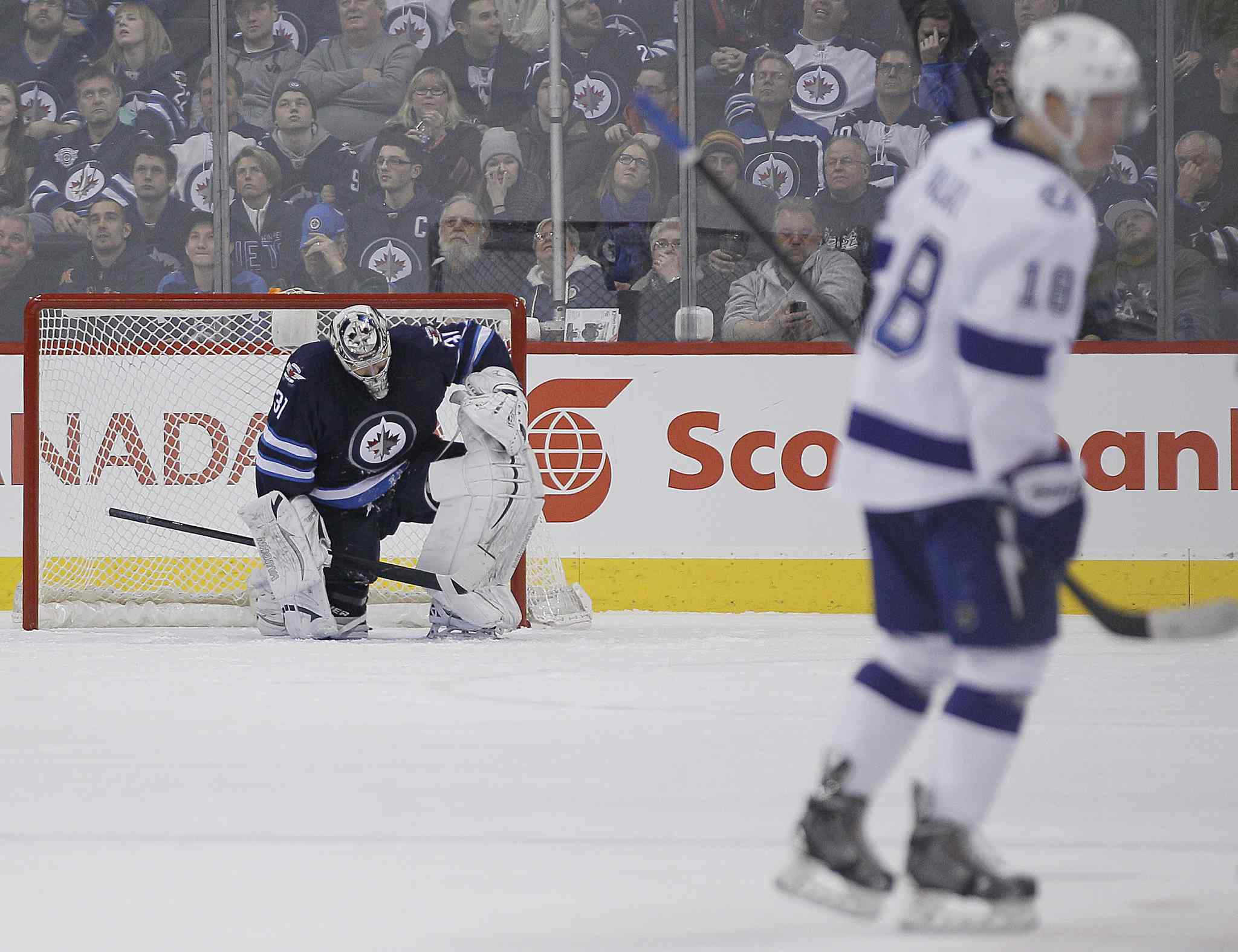 Winnipeg Jets' goaltender Ondrej Pavelec (31) hangs his head after being scored on by Tampa Bay Lightning's Ondrej Palat (18) during second period.