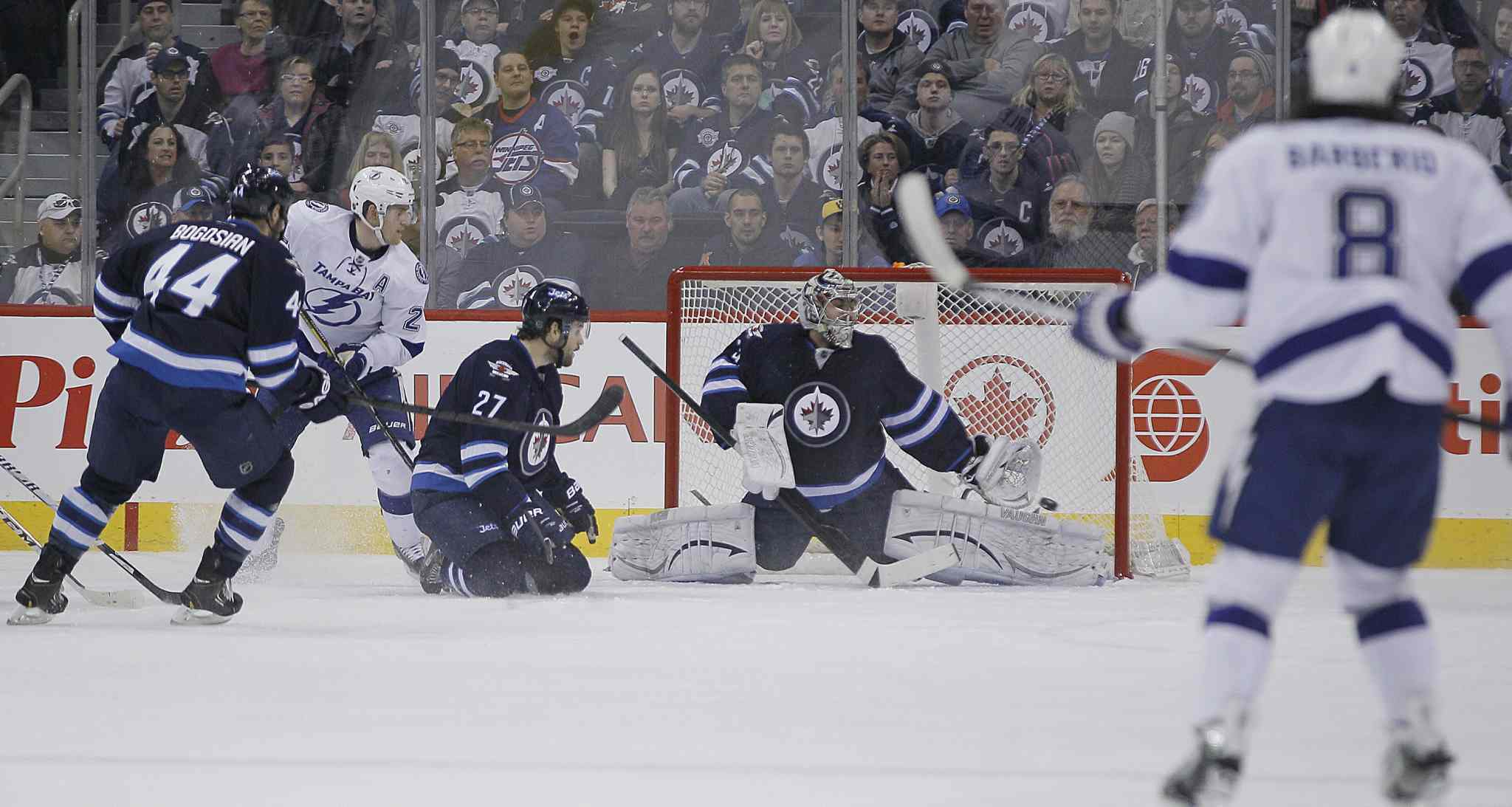 Winnipeg Jets' goaltender Ondrej Pavelec (31) can't stop the shot from Tampa Bay Lightning's Ondrej Palat (18) during second period.
