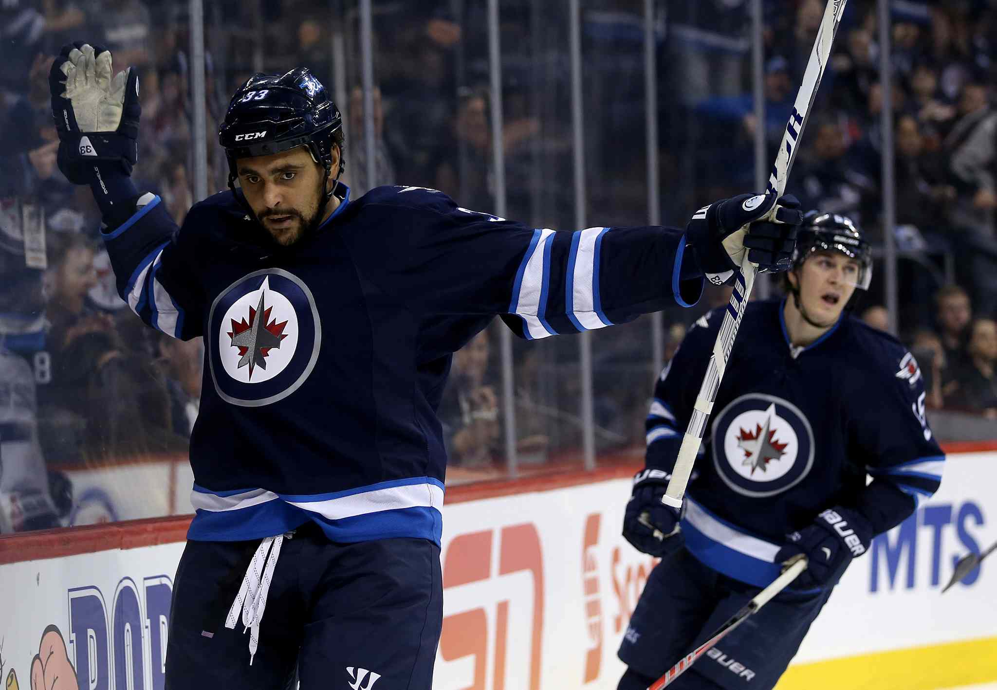 Winnipeg Jets' Dustin Byfuglien (33) celebrates a power play goal against the Tampa Bay Lightning during second period Tuesday.