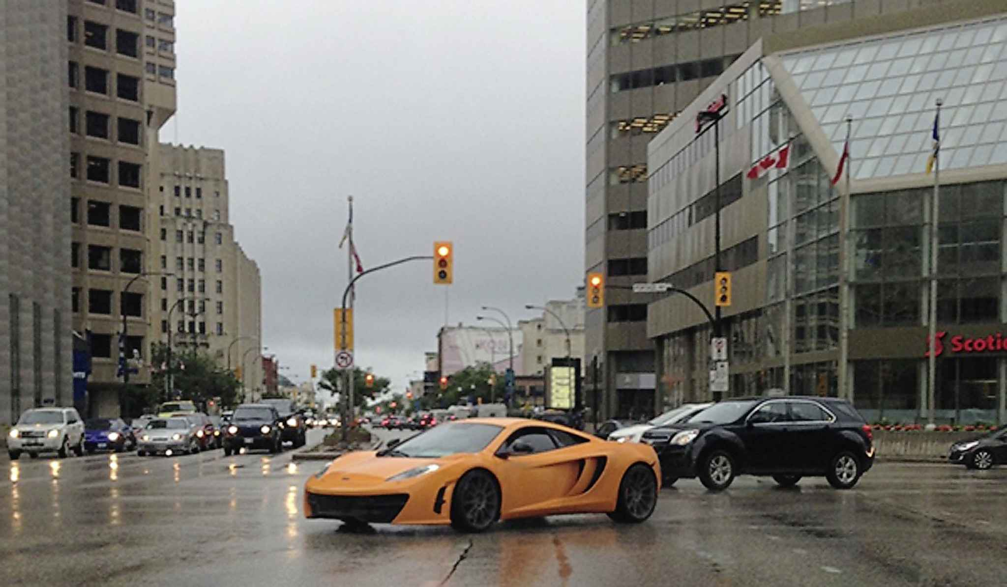 A McLaren sports car was among the luxury vehicles Ramdath drove. (Court document photo)