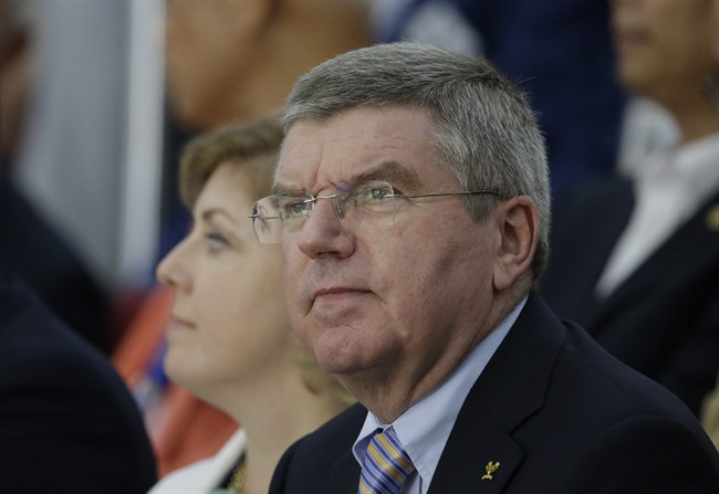 Thomas Bach, President of the International Olympic Committee (IOC) watches in the final of the 50m Pistol Men at the Ongnyeon International Shooting Range for the 17th Asian Games in Incheon, South Korea, Saturday, Sept. 20, 2014. (AP Photo/Lee Jin-man)