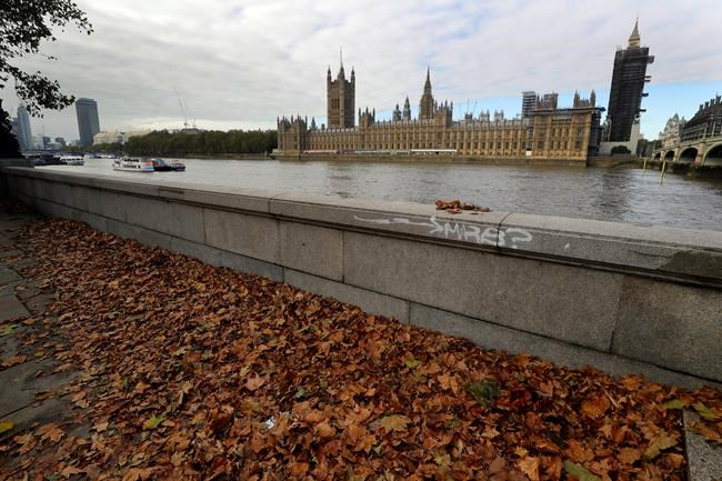"Fallen leaves on the ground opposite Britain's Parliament in London, Friday, Oct. 16, 2020. Britain's foreign minister says there are only narrow differences remaining in trade talks between the U.K. and the European Union. But Dominic Raab insists the bloc must show more ""flexibility"" if it wants to make a deal. (AP Photo/Kirsty Wigglesworth)"
