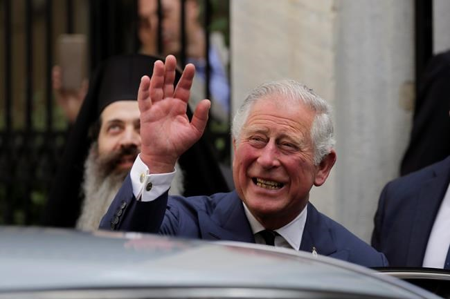 FILE - In this Thursday, May 10, 2018 file photo, Britain's Prince Charles, waves as he leaves a meeting with the head of Greece's Orthodox Church Archbishop Ieronymos, in Athens. Kensington Palace announced on Friday, May 18, 2018 Prince Charles will walk Meghan Markle down the aisle in her wedding to Prince Harry. (AP Photo/Petros Giannakouris)