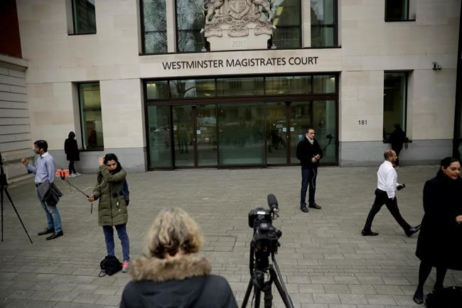 Members of the media report from outside Westminster Magistrates Court in London, shortly after fugitive Indian diamond tycoon Nirav Modi was denied bail in a hearing, Wednesday, March 20, 2019. Modi, who is wanted over his alleged involvement in a $2 billion banking fraud, has been arrested in London at the request of Indian authorities. (AP Photo/Matt Dunham)