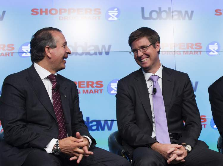 Michelle Siu / THE CANADIAN PRESS Domenic Pilla (left), president and CEO of Shoppers Drug Mart Corporation, and Galen G. Weston, executive chairman of Loblaw share a laugh at a Toronto press conference announcing Loblaw Companies Limited will acquire Shoppers Drug Mart Corporation for $12.4 billion in cash and stock.