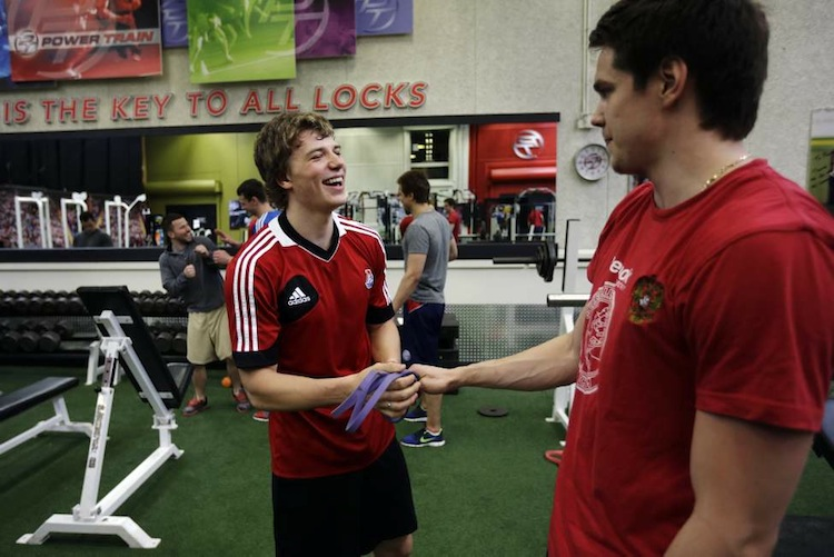 Yaroslavl Lokomotiv's Alex Kruchinin (left) and Emil Galimov laugh during a workout session, Thursday, May 9, 2013, in Manheim, Pa. The Russian hockey club continues to transform and rebuild far from the Volga River as the team rebuilds after one of the worst aviation disasters in sports history. (Matt Slocum / The Associated Press)