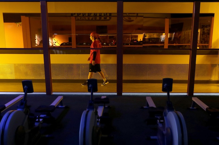 Yaroslavl Lokomotiv's Egor Yakovlev walks past a row of exercise machines after a workout session, Thursday, May 9, 2013, in Manheim, Pa.