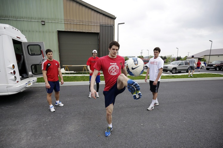 Yaroslavl Lokomotiv's Emil Galimov kicks a ball with teammates after a workout session Thursday, May 9, 2013, in Manheim, Pa.  (Matt Slocum / The Associated Press)
