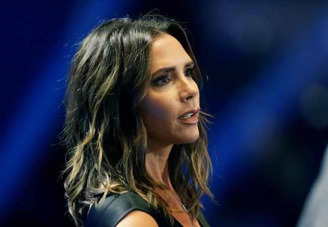 FILE - In this Thursday, Aug. 30, 2018 file photo, Victoria Beckham attends the UEFA Champions League draw at the Grimaldi Forum, in Monaco. Beckham has brought her fashion brand home to London Fashion Week for the first time to mark a decade in the business, it was reported on Sunday, Sept. 16, 2018. (AP Photo/Claude Paris, File)