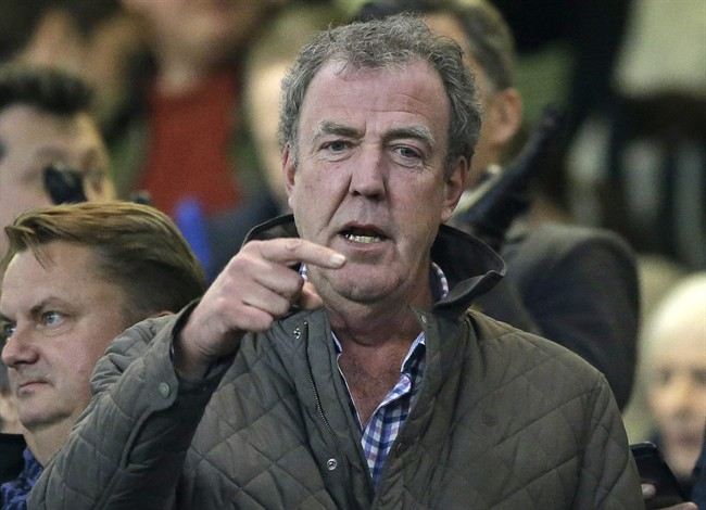"""FILE - This is a Wednesday, March 11, 2015 file photo of TV host Jeremy Clarkson as he gestures as he takes his place in the stands before the Champions League round of 16 second leg soccer match between Chelsea and Paris Saint Germain at Stamford Bridge stadium in London. The BBC said Wednesday March 25, 2015 that it has decided not to renew the contract of """"Top Gear'' host Jeremy Clarkson after a fracas with his producer. (AP Photo/Matt Dunham, File)"""