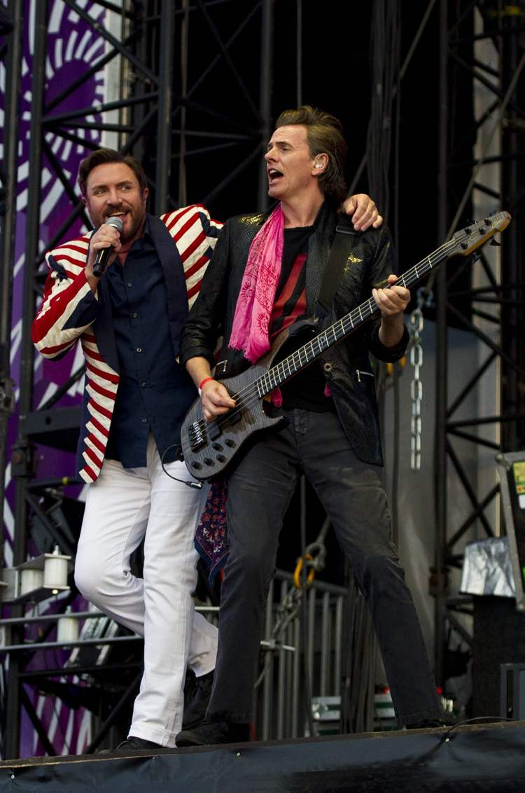Duran Duran perform at the Olympic Opening Ceremony Celebration Concert in Hyde Park, London, Friday, July 27, 2012. The concert is part of a series of events being organized by the Mayor of London, Boris Johnson, to celebrate the London 2012 Olympic Games. (James McCauley / The Associated Press)