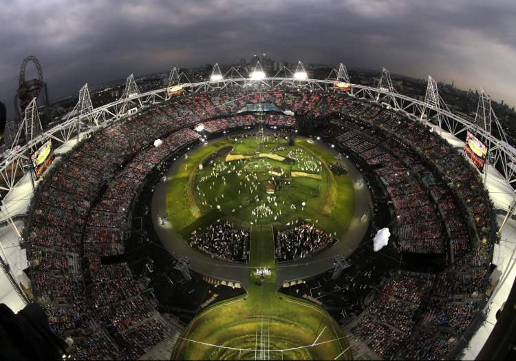 Performers gather during the Opening Ceremony at the 2012 Summer Olympics, Friday, July 27, 2012, in London.  (David J. Phillip / The Associated Press)
