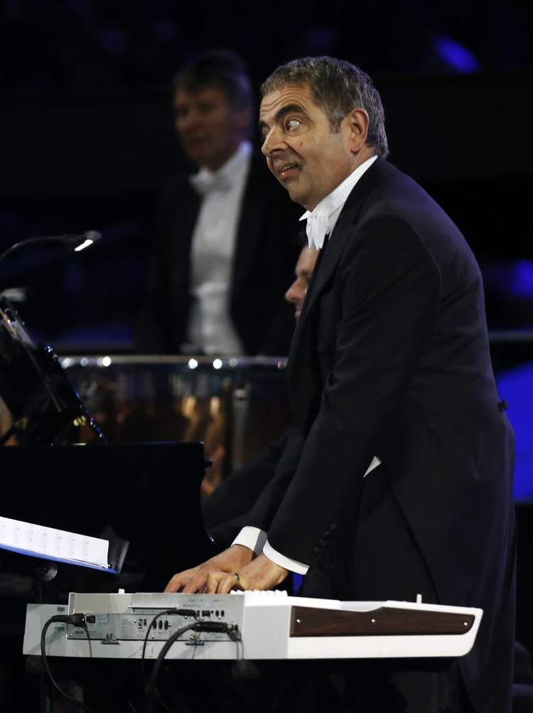 Actor Rowan Atkinson performs during the Opening Ceremony at the 2012 Summer Olympics, Friday, July 27, 2012, in London.  (Matt Dunham / The Associated Press)