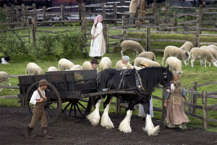 A pastoral farm scene is enacted during the pre-show for the Olympic Games Opening ceremonies in London on Friday July 27, 2012.