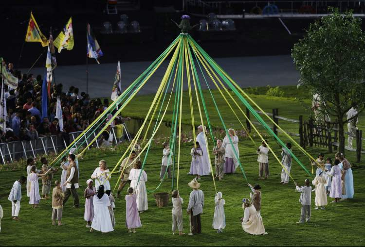 Performers make a circle during the Opening Ceremony at the 2012 Summer Olympics, Friday, July 27, 2012, in London.  (Charlie Riedel / The Associated Press)