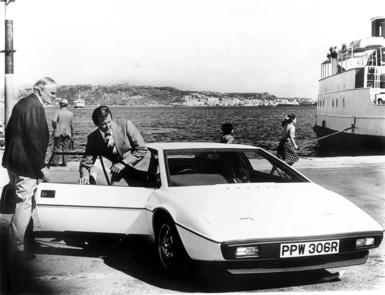 "Actor Roger Moore, as James Bond in ''The Spy Who Loved Me,"" gets into a 1976 Lotus.  (007magazine / Bonhams / BLOOMBERG NEWS)"