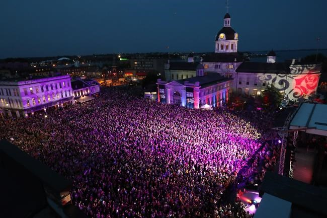 People who couldn't get a ticket to the concert gather in Springer Market Square to listen to the Tragically Hip in downtown Kingston, Ont., on Saturday, August 20, 2016. THE CANADIAN PRESS/Lars Hagberg