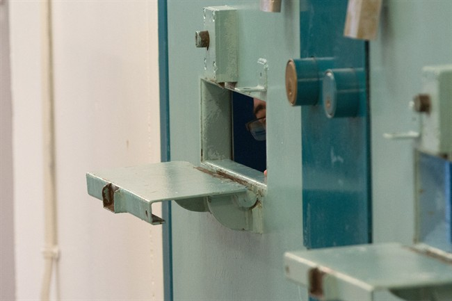 An inmate can be seen inside a segregation cell during a media tour of the Collins Bay Institution in Kingston, Ont., on Tuesday, May 10, 2016. People convicted of minor offences would pay less than those guilty of serious crimes when applying for a pardon under a scenario being studied by the federal parole board. THE CANADIAN/Lars Hagberg