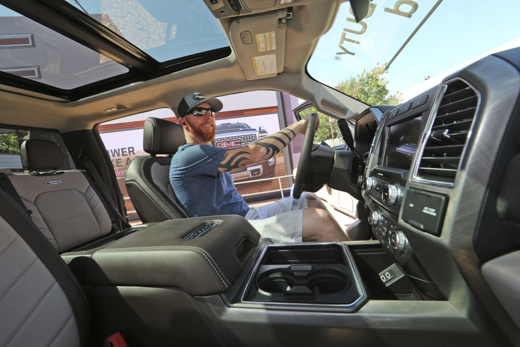 A Per Checks Out The Interior Of New Pickup Truck That Has All Latest