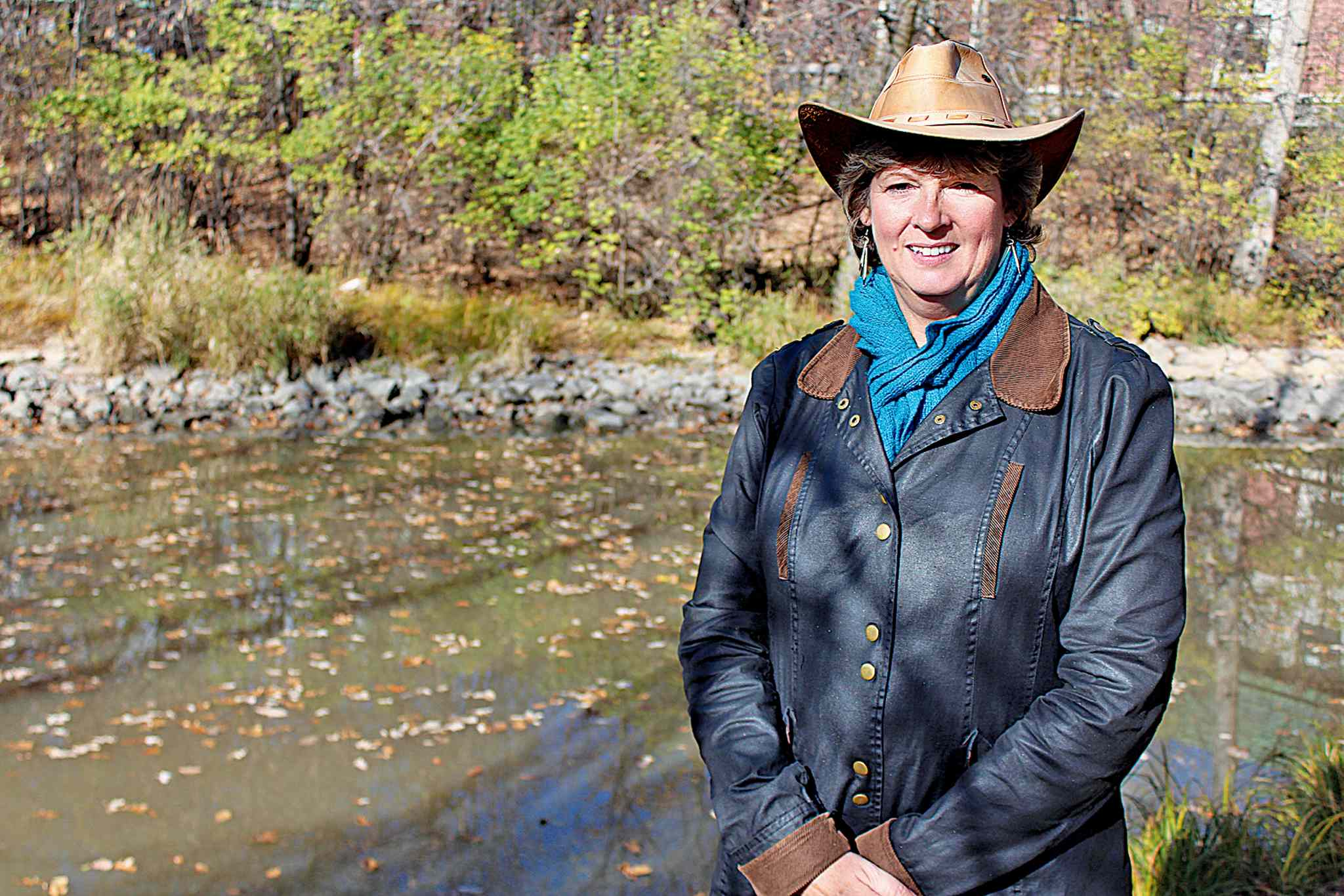 Michele Kading, Save Our Seine's executive director, by the Seine River near the Royalwood Bridge on a sunny fall day recently.