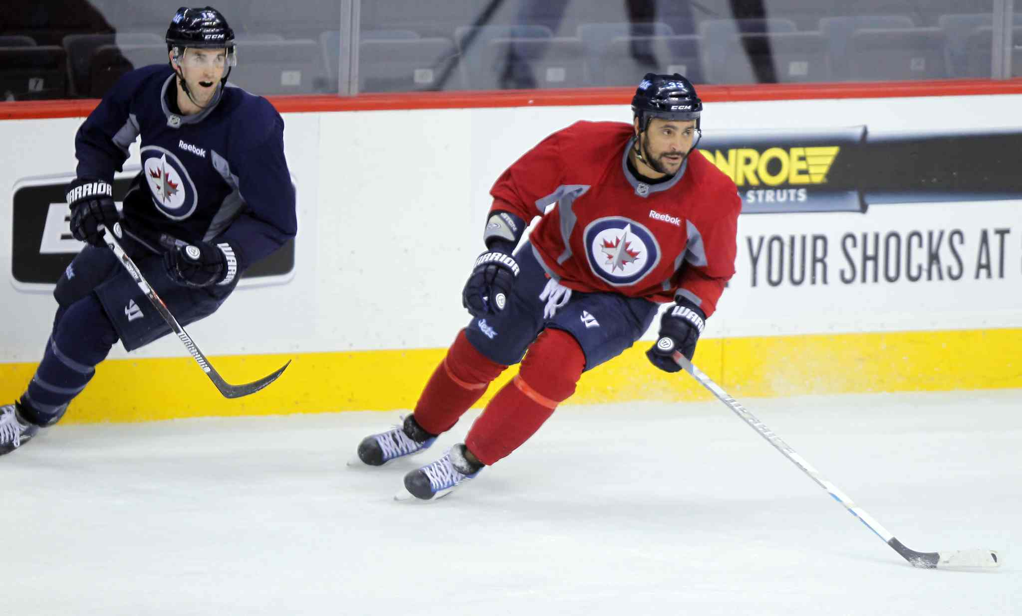 Captain Andrew Ladd, left, and defenceman Dustin Byfuglien's contract issues are a priority says the Jets GM.