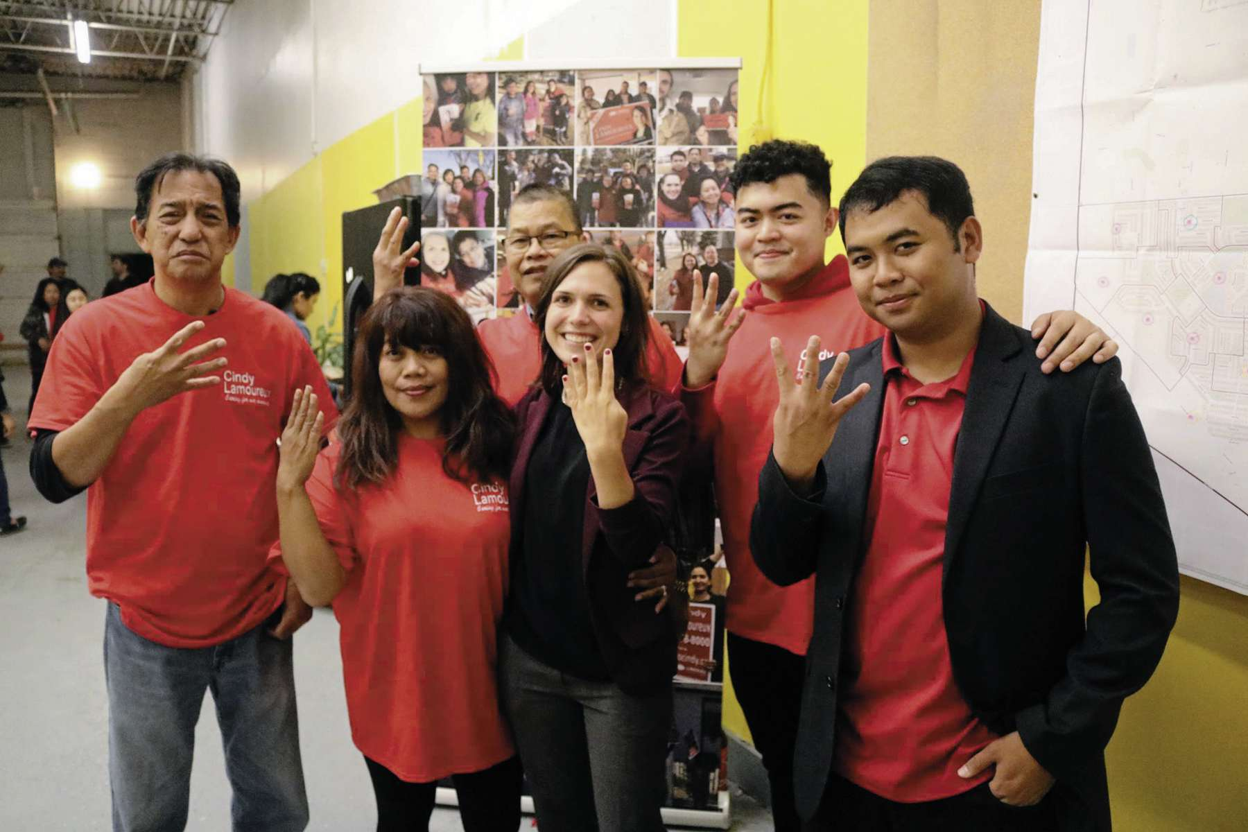 Cindy Lamoureux, Liberal MLA-elect for Tyndall Park, and some of her supporters signal that she's headed for four more years at the Manitoba Legislature.