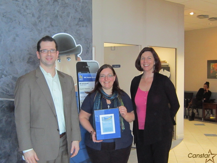 Laura Ruppel (centre) received a RBC Royal Bank community leadership award from Adam Hagarty, manager Western Canada Contact Centre, and Jacqueline Melito, team manager Online Credit.