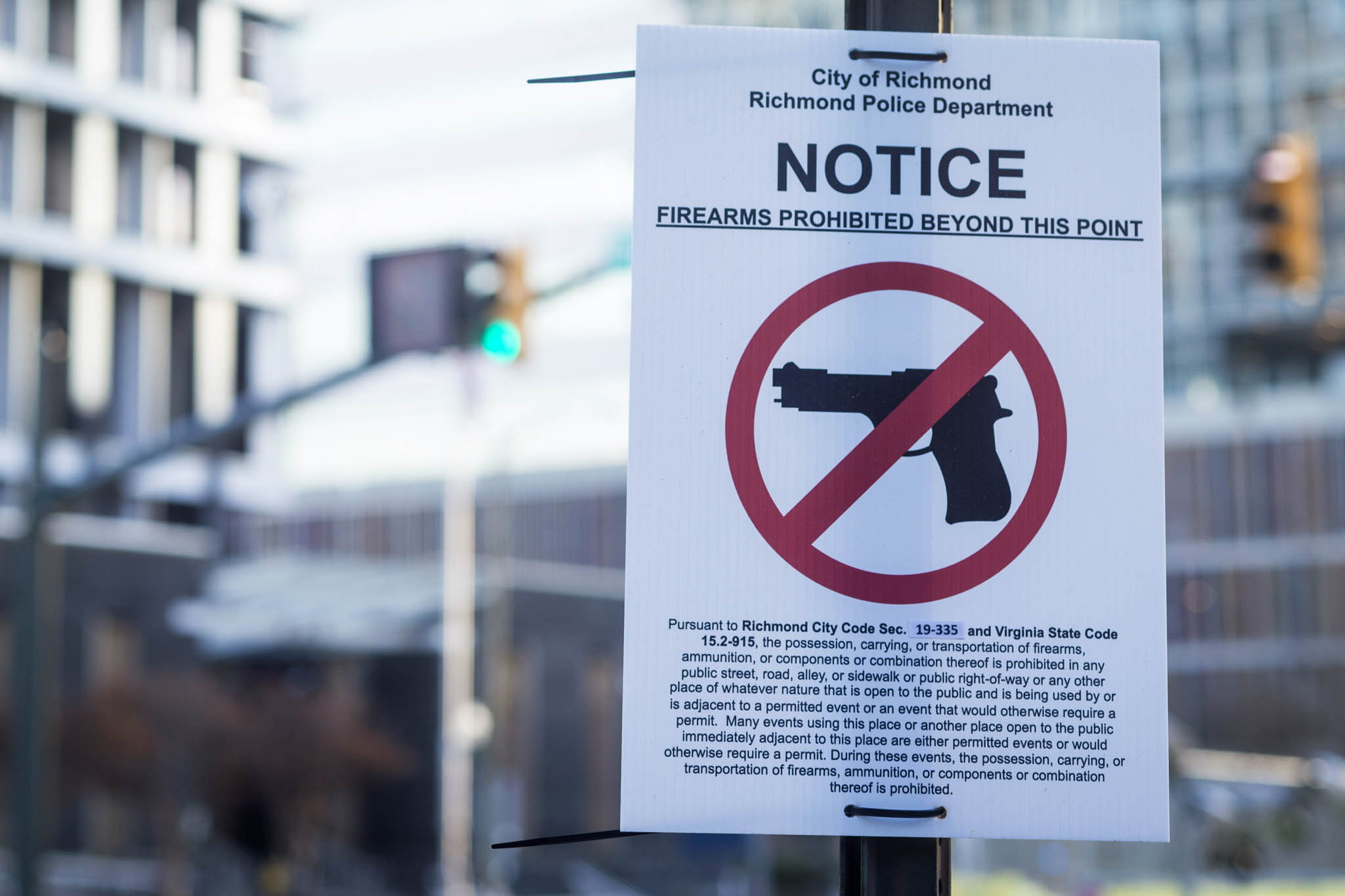 A sign reminds people in Richmond, that carrying firearms near Capitol Square is a violation of a city ordinance.