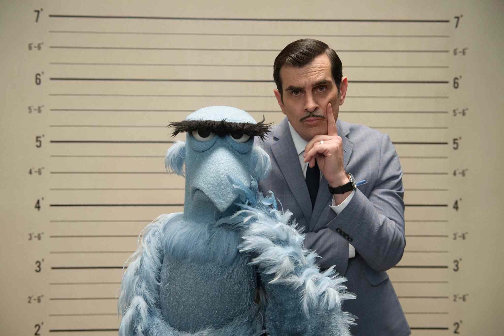 Sam the Eagle and Ty Burrell compete to see who has the most impressive glower.