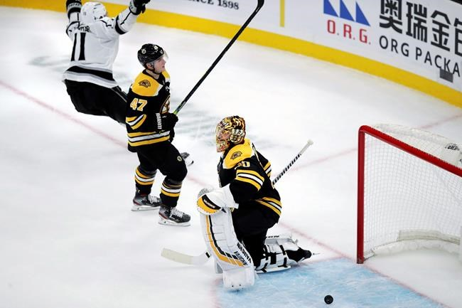 Boston Bruins goaltender Tuukka Rask drops to a knee after giving up the game-winning goal to Los Angeles Kings center Anze Kopitar (11) during an overtime period of an NHL hockey game in Boston, Tuesday, Dec. 17, 2019. The Kings won 4-3. At center is Boston Bruins defenseman Torey Krug (47).(AP Photo/Charles Krupa)