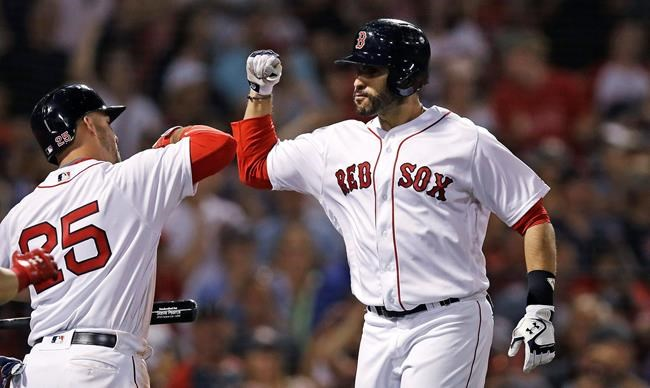 Boston Red Sox's J.D. Martinez, right, is congratulated by Steve Pearce after his three run home run during the eighth inning of a baseball game against the Texas Rangers at Fenway Park in Boston, Monday, July 9, 2018. (AP Photo/Charles Krupa)