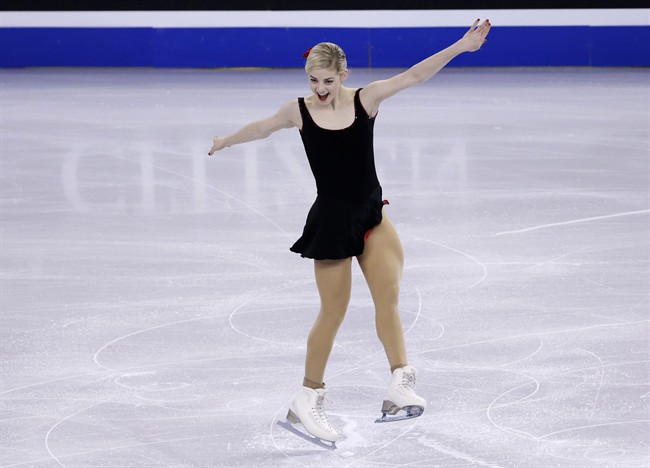 RETRANSMISSION TO CORRECT DAY TO THURSDAY - Gracie Gold, of the United States, completes her routine during the women's short program in the World Figure Skating Championships, Thursday, March 31, 2016, in Boston. (AP Photo/Elise Amendola)