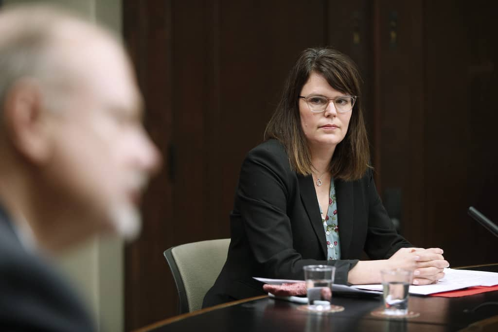 Dana Rudy, deputy minister, Manitoba Education, right, listens to Education Minister Kelvin Goertzen speak to media during a press conference at the Manitoba Legislature in Winnipeg on Wednesday.