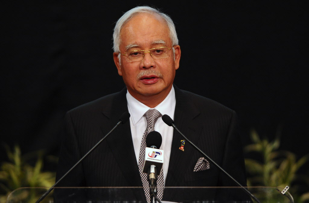 Malaysian Prime Minister Najib Razak speaks during a press conference for the missing Malaysia Airlines, flight MH370, in Kuala Lumpur, Malaysia on Monday. A new analysis of satellite data indicates the missing Malaysia Airlines plane crashed into a remote corner of the Indian Ocean, Najib said Monday.  (Joshua Paul / The Associated Press)