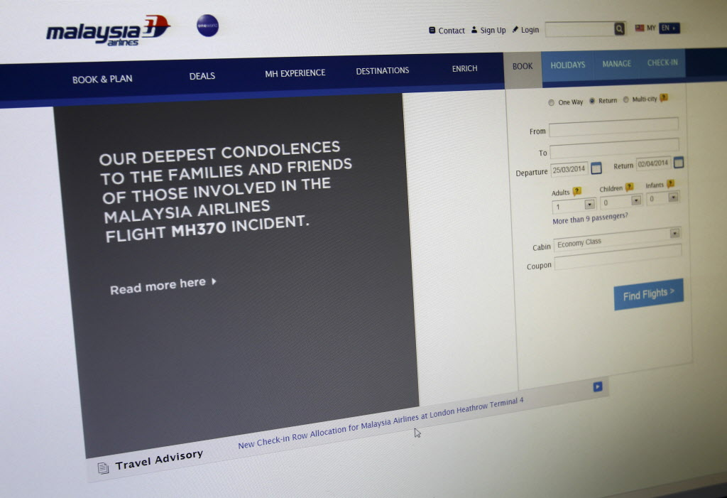 A sympathy message is displayed at the webpage of the Malaysia Airlines website, in Shah Alam, outside Kuala Lumpur, Malaysia on Tuesday, after Malaysia's prime minister announced that data indicate the plane is believed to have crashed in the Indian Ocean. (CP)