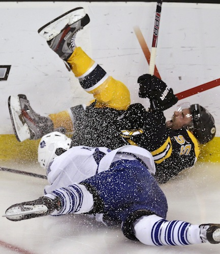 Toronto Maple Leafs center Nazem Kadri gets physical with Boston Bruins defenceman Johnny Boychuk as the two go crashing to the ice in the second period. (Charles Krupa / The Associated Press)