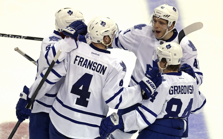 Toronto Maple Leafs defenseman Cody Franson is congratulated by teammates after scoring his second goal of the night against the Boston Bruins. After 40 minutes, the Leafs were ahead 2-1. (Charles Krupa / The Associated Press)