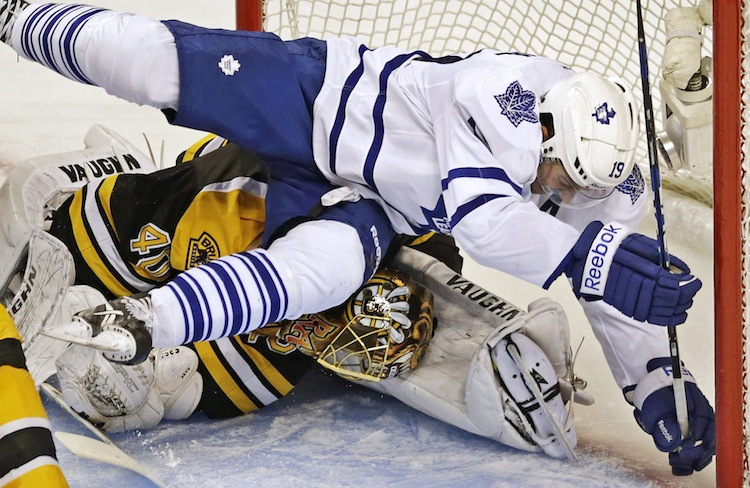 The blue paint of the crease didn't stop Toronto Maple Leafs winger Joffrey Lupul from ending up on top of Boston Bruins goalie Tuukka Rask during the second period. (Charles Krupa / The Associated Press)
