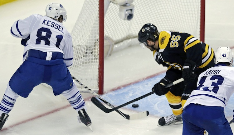 Toronto Maple Leafs winger Phil Kessel beats Boston Bruins defenceman Johnny Boychuk and scores, putting the Leafs up 3-1 in the third period. (Charles Krupa / The Associated Press)