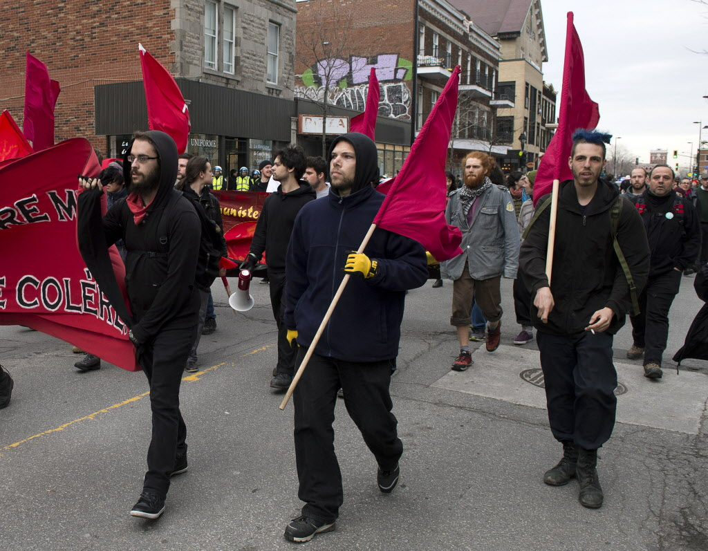 Montreal protesters march during an annual May Day anti-capitalism demonstration on Thursday. (Ryan Remiorz / The Canadian Press)